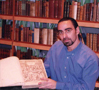 Federico Andahazi holding one of the rare copies of Mateo Colon's work, 'De re anatómica' of 1559 at the Stockholm Library, Swiss land (1997)